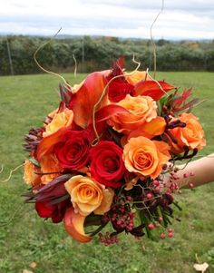 Bold, bright fall colored bouquet. This bouquet is going to pop against a white or off white wedding dress!