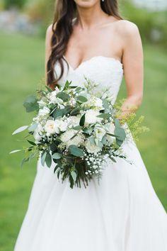 White Roses, White English Garden Roses, White Lisianthus, White Gypsophila (Baby's Breath), Green Seeded Eucalyptus, Silver Dollar Eucalyptus Exquisite Bridal Bouquet
