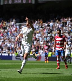 Gareth Bale of Real Madrid CF celebrates after scoring his team's opening goal during the La Liga match between Real Madrid CF and Granada CF at Estadio Santiago Bernabeu on April 5, 2015 in Madrid, Spain.