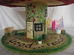 I need book corner seats! Is tuffet making easy? Seats made from empty cable spools. Picnic under a tree tuffet. Cable Reel Ideas Eyfs, Electrical Spools, Wooden Cable Reel, Early Years Classroom, Cable Drum, Craft Stalls, Small World Play, Storybook Gardens, Wooden Spools