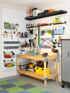 Attach customizable wall panels to a garage wall and, voila-- you can store hundreds of large and small items in organized fashion. Use open baskets to hold power cords and paper towels, hang rolls of tape from L-shape hooks, and add shelves for paint cans. As a complement to the open storage, introduce a lockable cabinet to hold hazardous chemicals, such as gasoline, oil, and paint thinner.