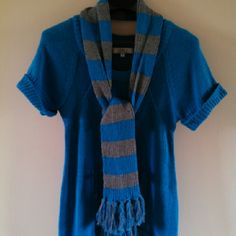 lei Scoop Neck Short Sleeve Sweater & Scarf 10% off 2+ bundle! :-)  Teal scoop neck short sleeve knit sweater with front pocket & banded bottom. Includes teal & gray scarf. Both are in very good condition. Machine wash cold gentle cycle & dry flat. lei Sweaters Crew & Scoop Necks