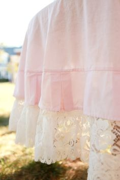 maybe I could turn a top sheet into crib dust ruffle and add some lace like this?