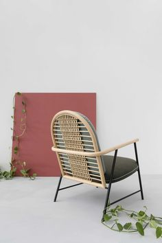 A collection by Sep Verboom that consists of a lounge chair and shelves, both designed with rattan material as the focus and industrial metal as the accent.