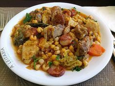 Cachupa - National dish of Cape Verde. Stew filled with hominy, beans and meat of fish, sausage, beef, goat or chicken.