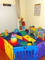 Daycare room idea - serve as both an infant play area and nap time area for older kids; include a low wall mirror.