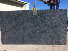 Blue Pearl granite is a beautiful natural stone, with uniform pattern in slab. A perfect granite  which goes with light kitchen cabinet.