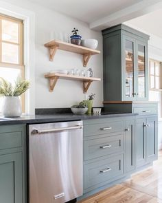 Searching for the perfect cabinet color for my laundry room and I think I may have found it! This kitchen is Retreat by Sherwin Williams…