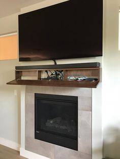 Modern walnut fireplace mantel with drop front shelf, media storage, hidden storage. 15 Best Hidden Storage Ideas and Designs for 201915 Best Hidden Storage Ideas and Designs for Fireplace Cabinet with Hidden Storage Small Apartment Decorating, Room Design, Tv Over Fireplace, Family Room Design, Fireplace Tv Wall, Hidden Storage, Fireplace Mantels, Fireplace, Fireplace Wall