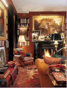 Room by Ralph Lauren. Brown leather, multiple plaids, rich muted paisley pillow. Rich reds, touch of hunter green (also plaid).