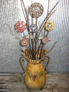 Industrial colored faucet handles as flowers. (Add a few real twigs to complement.)