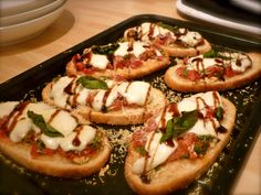 Tidy starter. Super cheap too. Slice the baguette in nice pieces of bread and spread them out on a roasting pan. Mix olive oil and lots of crushed garlic in a cup, and spread it on every slice of b...