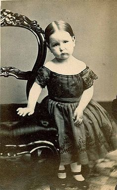 Little girl with a sweet sad face
