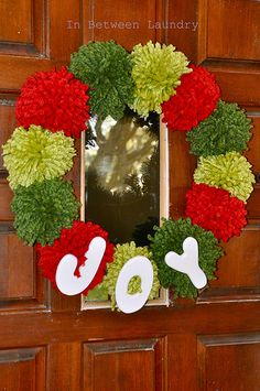 Pom pom Christmas Wreath. What about all red for the ho ho wreath @Kathleen S Reverman ?