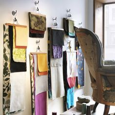Some fabrics are too beautiful to hide away.  Use the BUMERANG pants hanger to display your textiles on the wall.
