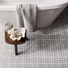 We love the pretty floral silhouette print of our Dee Hardwick vinyl floor tiles! Perfect for creating a subtly feminine look in the bathroom or any other room in the home! Shown here in a soothing shade of Pebble Grey Bathroom Vinyl, Bathroom Floor Tiles, Master Bathroom, Bathroom Storage, Bathroom Grey, 1950s Bathroom, Bathroom Vintage, Vinyl Flooring Bathroom, Narrow Bathroom