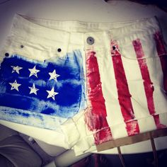 American Flag shorts. DYI Super easy with tape (for stripes) and star stickers, red and blue paint.