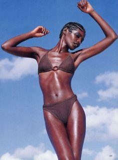 """Beyond Bronze""   VOGUE US, June 1997   Photographer: Herb Ritts   Model: Kiara Kabukuru"