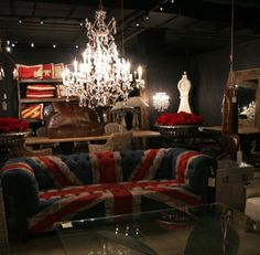 Union Jack couch, chandelier, dark room interior decorum living room eclectic