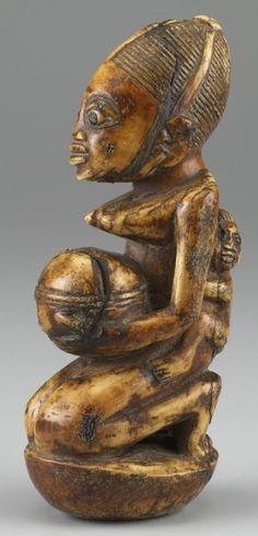 Maternity Figure ARTIST:Yoruba DATE:18th century MEDIUM:Ivory