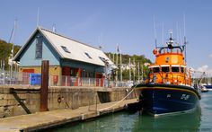 RNLB 17-09 City of London II Lifeboat, Crosswall Quay, Dover Marina, Kent, England, UK. Severn-class rescue craft shown moored against the floating pontoon in the Tidal Harbour below the Dover Lifeboat Station building. Vessel replaced the Thames-class Rotary Service (50-001) in 1997. Royal National Lifeboat Institution, RNLI, is a registered charity. Background: Western Heights, Wellington Dock swing-bridge, and DHB Dovorian Harbour Patrol Launch. See…