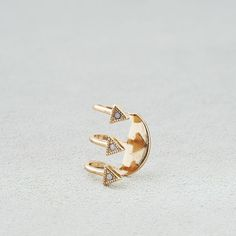 AE Opal Triangle Ear Cuff ($9.95) ❤ liked on Polyvore featuring jewelry, metallic, opal jewellery, triangle jewelry, american eagle outfitters, opal jewelry and ear cuff jewelry