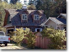 Gambrel, barn-style, pointy roof details, cupola, cedar shingles, rounded dormers, very slight shed roof