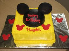 Mickey Mouse Hat cake - WASC with Indydebi's buttercream frosting.  The hat is triple chocolate sour cream cake with chocolate buttercream.  The ears and red Mickey Mouse shapes are candy melts.