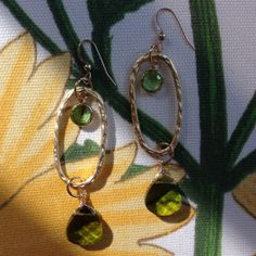 Unique golden hoops with free flowing citrine and olive Swarovski crystals ~ $28  www.designingcrystal.com More colors coming soon!