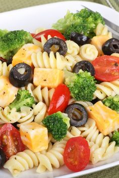 Recipe including course(s): Entrée; and ingredients: black olives, broccoli, cheese, cherry tomato, fusilli pasta, garlic, Italian seasoning, olive oil, pepper, pepperoni, red onion, red wine vinegar, salt