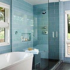 BHG - bathrooms - freestanding, tub, stagger, blue, glass tiles, shower surround, backsplash, frameless glass shower, faux wood, tiles, floo...