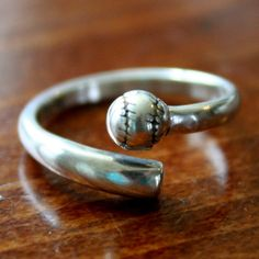 This sterling silverring is a perfect jewelry gift for yourself, softball player, softball coach or baseball fan to show their love for their favorite sport.Thebaseball /softballring features an adjustable band accented with abaseball/softball.