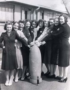 Kirkby, Merseyside, munitions factory workers pose around a bomb Liverpool Town, Liverpool History, Ww2 Bomb, Canadian History, American History, Female Hero, Vintage London, Women In History, World War Ii