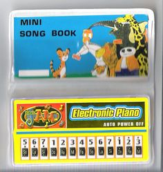 """mini pianos with song books - I think we could buy these at """"Santa's Workshop"""" in elementary school...."""