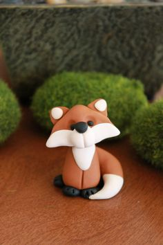 This listing is for one (1) hand sculpted polymer clay woodland style fox. He stands approximately 2 all. He would look adorable in a gnome or fairy