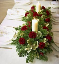 Christmas Table Centerpiece~ Gorgeous arrangement of greenery and candles! Could be done using tree clippings stuck into a soaked oasis block. Christmas Flower Arrangements, Christmas Table Centerpieces, Christmas Flowers, Christmas Tablescapes, Xmas Decorations, Floral Arrangements, Christmas Holidays, Christmas Wreaths, Table Arrangements