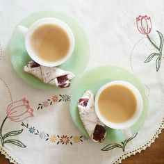 Fire King coffee cups & Jadeite saucers, vintage linen