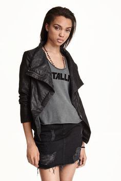 Biker jacket: Biker jacket in imitation leather with a concealed diagonal zip at the front, ribbed jersey sections under the arms, and side pockets. Lined.