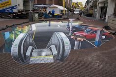 During the famous Stoppelhaene Festival in Raalte, Planet Streetpainting was invited to make 2 large 3d street paintings. Leon Keer, Peter Westerink, Ruben Poncia and Remko van Schaik made this 3d street art by painting an underground parking garage   - more at www.streetart.nl #3d #streetart