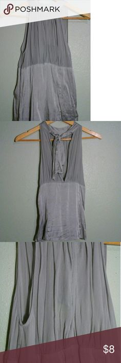 Silver Shimmer Top Brand: Charlotte Russe  Size: S Color: Silver Made out of: Silk  Condition: Good condition. No noticeable imperfections. Worn a bit but still loveable. See through Tank.  ** Selling as is** ❗I post/sell the same items on Vinted (for a much lower price), so if you don't see an item in here anymore someone else bought the item already❗ :) (Vinted: CoffeeSocks )  ❕3+ Items get Box shipping instead of Poly Mailers. ❕Sweater/Jackets/ Anything big related to size will also get…