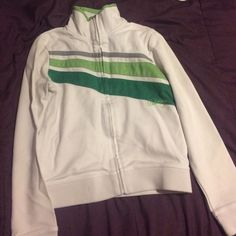 Sweater Dark green, light green, and grey strip on the front of the white jacket. Billabong Sweaters