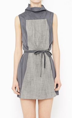 high neck. simple silhouette with belt tie for shape.