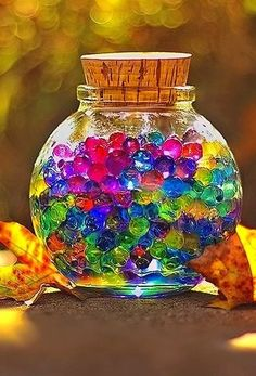 Colorful glass marbles in glass jar