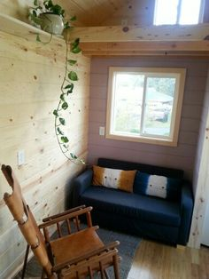 Like the idea of being able to have a couch (this one looks like a sofa bed style) in a tiny house, rather than a bench with a cushion.