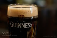 """A pint of Guinness. by FranciscoGarciaRios from http://500px.com/photo/198105039 - Music (Open link in new tab) / Música (abrir en nueva pestaña): The Chieftains - O'Sullivans March. A pint of Guinness close-up. Sony ILCE-5100  Canon EF 50mm f/1.4 USM My Facebook Page -Español: """"Una pinta de Guinness"""" Primer plano de una pinta de Guinness. Sony ILCE-5100  Canon EF 50mm f/1.4 USM Mi página en Facebook. Imagen protegida por Plaghunter / Image protected by Plaghunter  Francisco García Ríos…"""