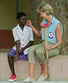 PRINCESS DIANA IN ANGOLA  Diana returned to Angola several times after her first visit and is pictured here in 1997 with a girl who lost her leg to a landmine. The Fund currently set up in her name also works to change legislation and policy to meet international standards on children's rights.