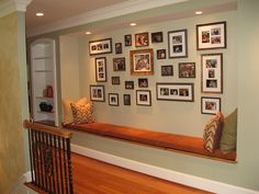 family photo wall. my dream house has a hall like this :)