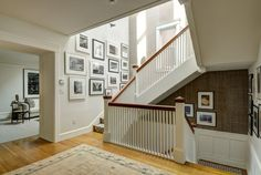 Black-and-white photography in alternating black and white frames adds structure and interest to this stairwell. It gives the space the aura of a gallery. #interiordesign #ericcohler #ericcohlerdesign #art #photography #stairwell #design