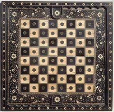 Satranç ve oyun tahtası ..abanoz,siyah ahşap,fildişi,yeşil boyalı fildişi, boynuz ve altından yapılmıştır.(43x41.9 cm) 16.y.y., Kuzey İtalya Metropolitan Müzesi, New York