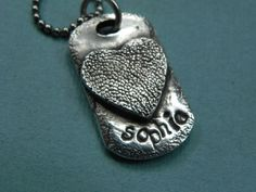 Hey, I found this really awesome Etsy listing at http://www.etsy.com/listing/83138994/dog-paw-print-jewelry-silver